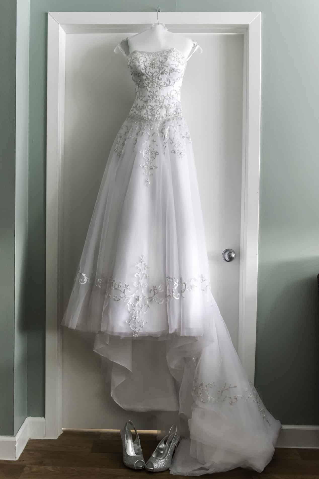Beautiful Wedding Dress hanging on a door