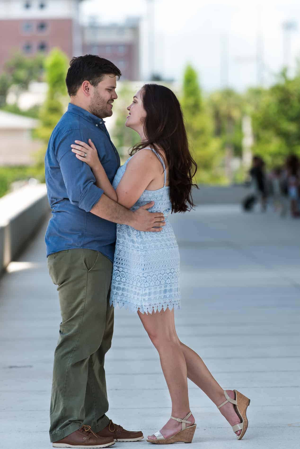 Engaged Couple being photographed in Downtown Tampa