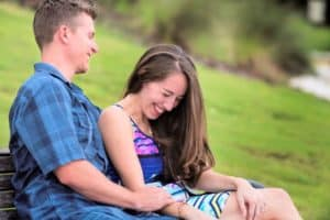 Groom makes her laugh during engagement photos