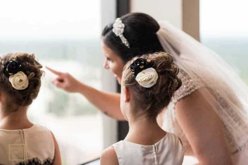 Bride and flowergirls look out the window at Citrus Club Wedding