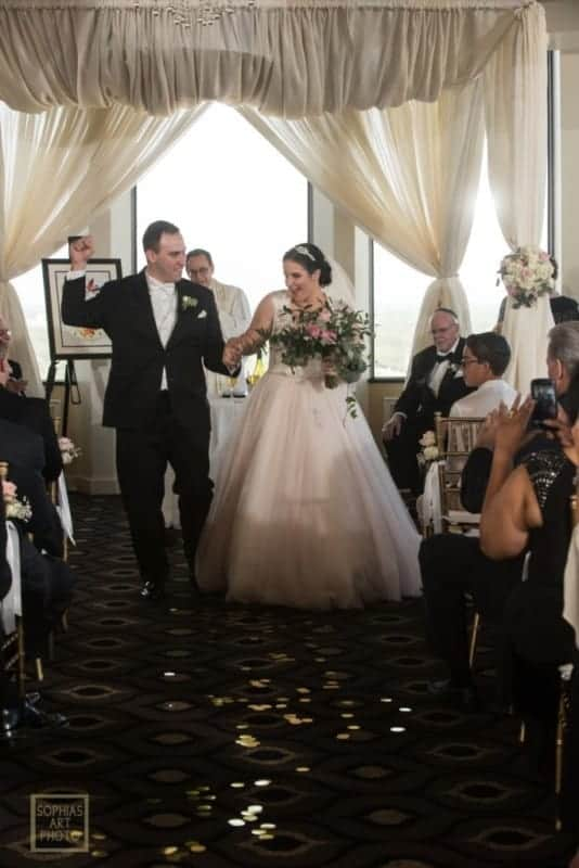 Bride and Groom first kiss at Citrus Club Wedding