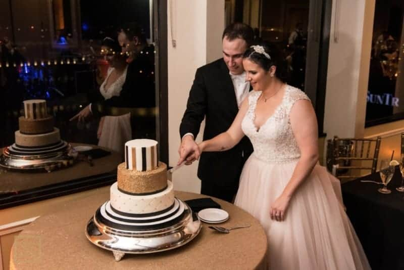 Citrus Club Bride and Groom cutting cake at Citrus Club Wedding