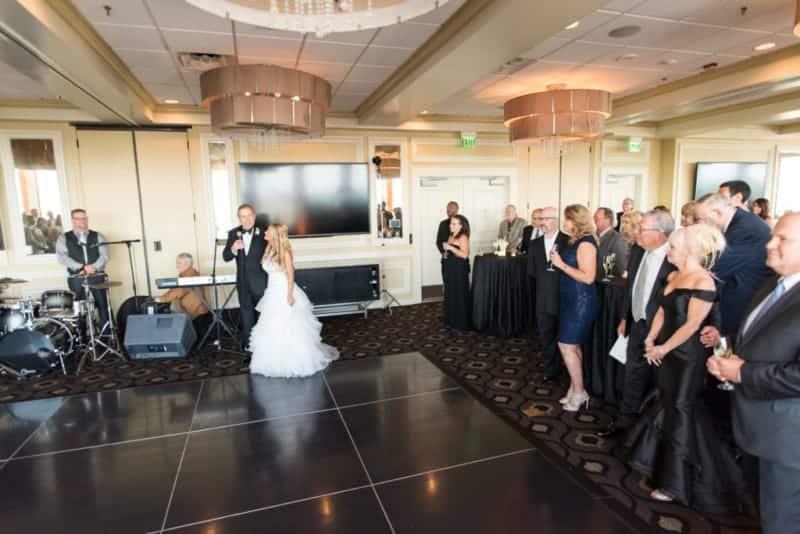 Couple having a first dance at a Citrus Club Wedding
