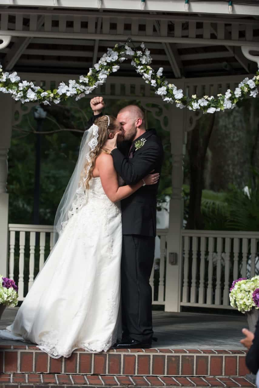 First Kiss at their Dr Phillips House The Courtyard at Lake Lucerne Wedding
