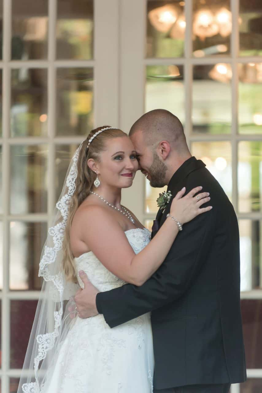 Couple embraces during wedding Photos