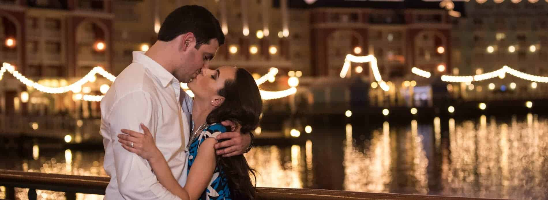 Couple at sunset in front of bay at Disney Boardwalk
