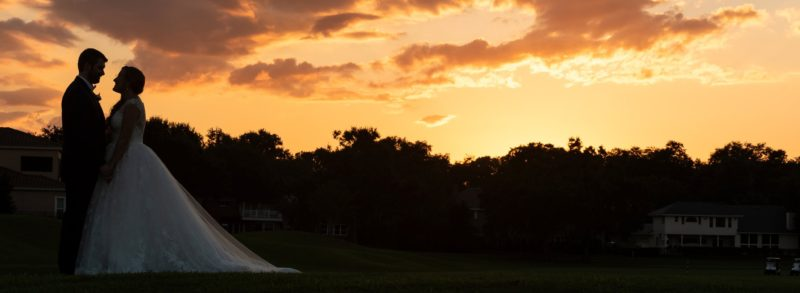 Couples portrait at sunset on the country club golf course