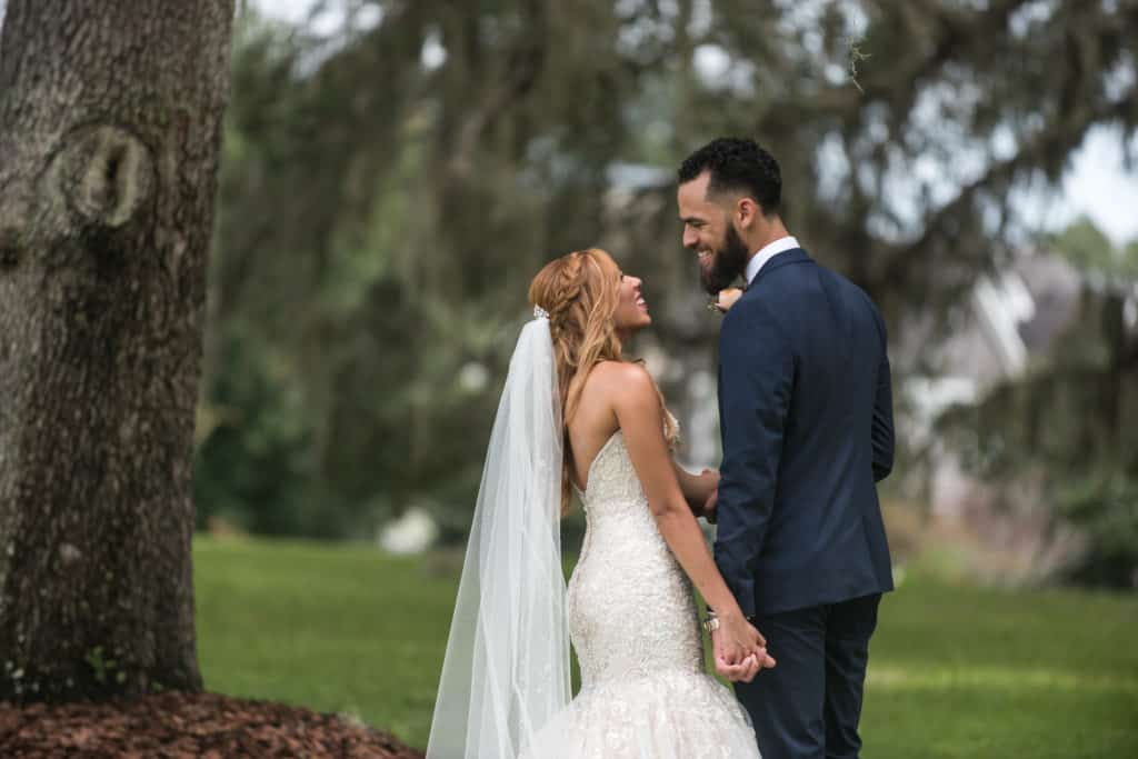Groom smiles at Bride outdoors in Orlando Florida - The Best Wedding Venues Orlando has to offer
