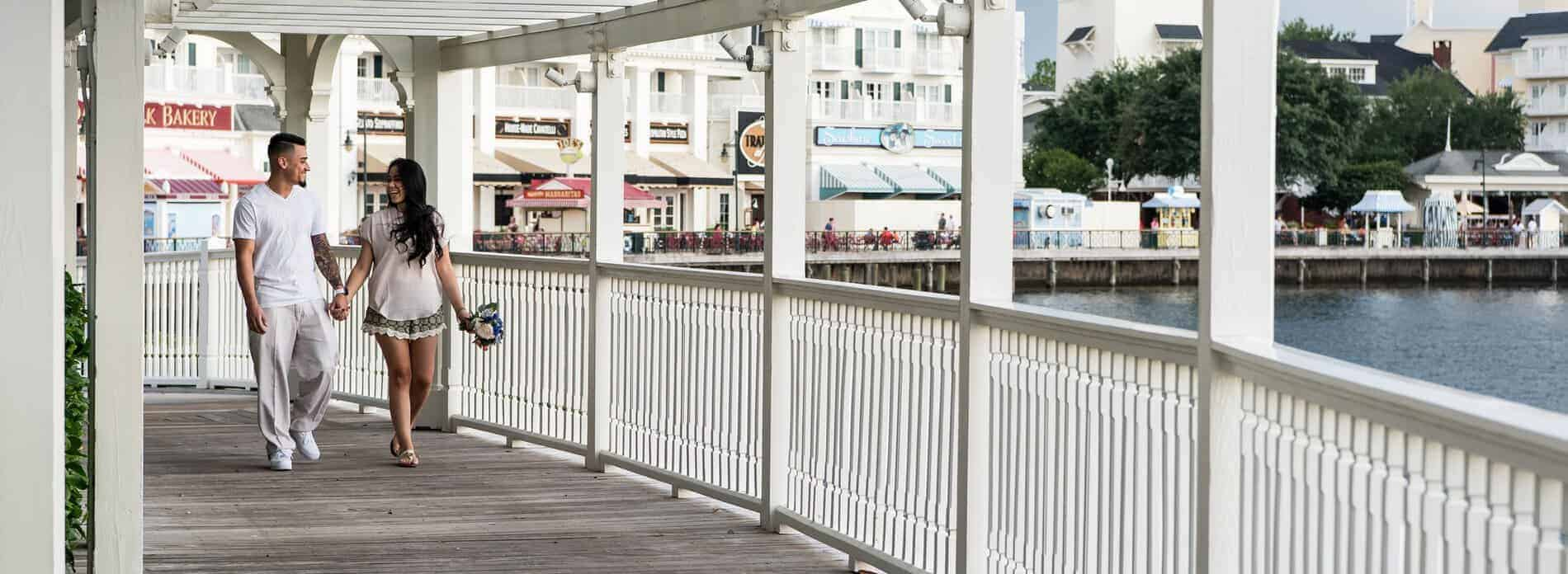 Couple walk to the pavilion at Disney Boardwalk.