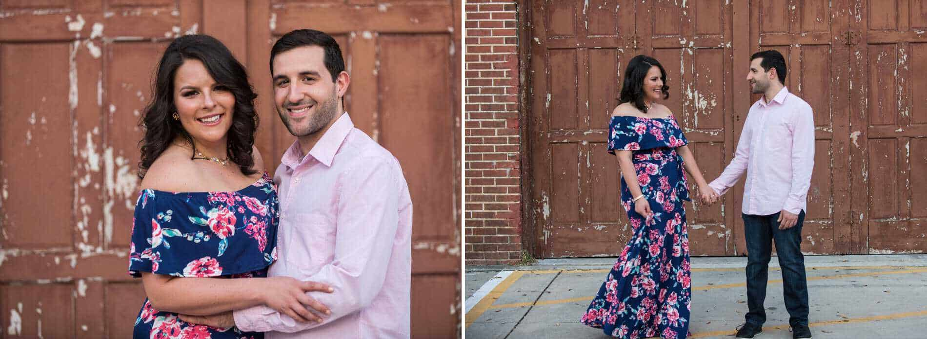 Engaged couple poses in front of the red doors at the Winter Garden Theater.
