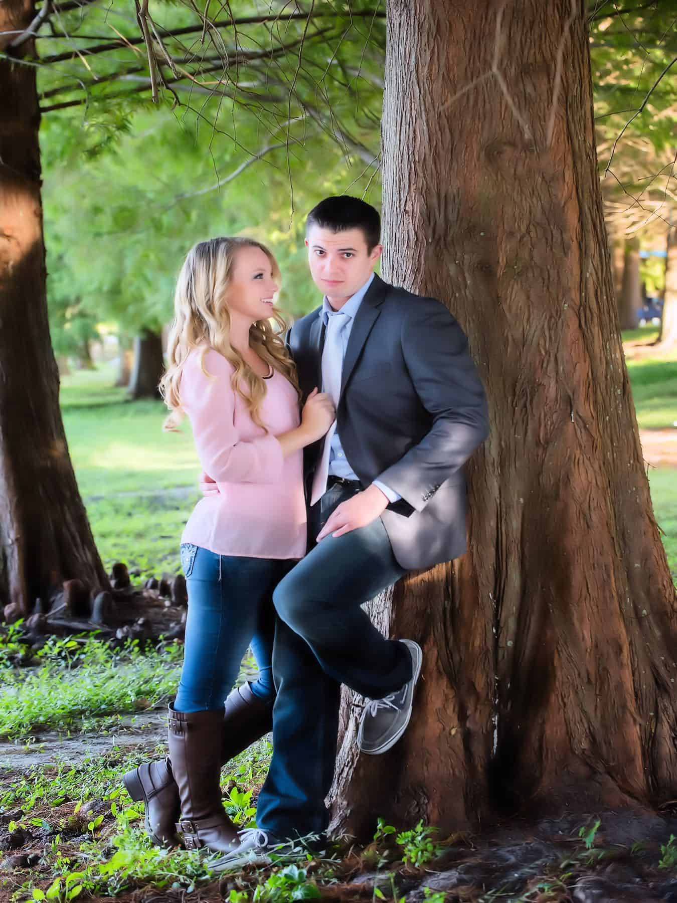 Couple pose by a tree in Bill Frederick Park