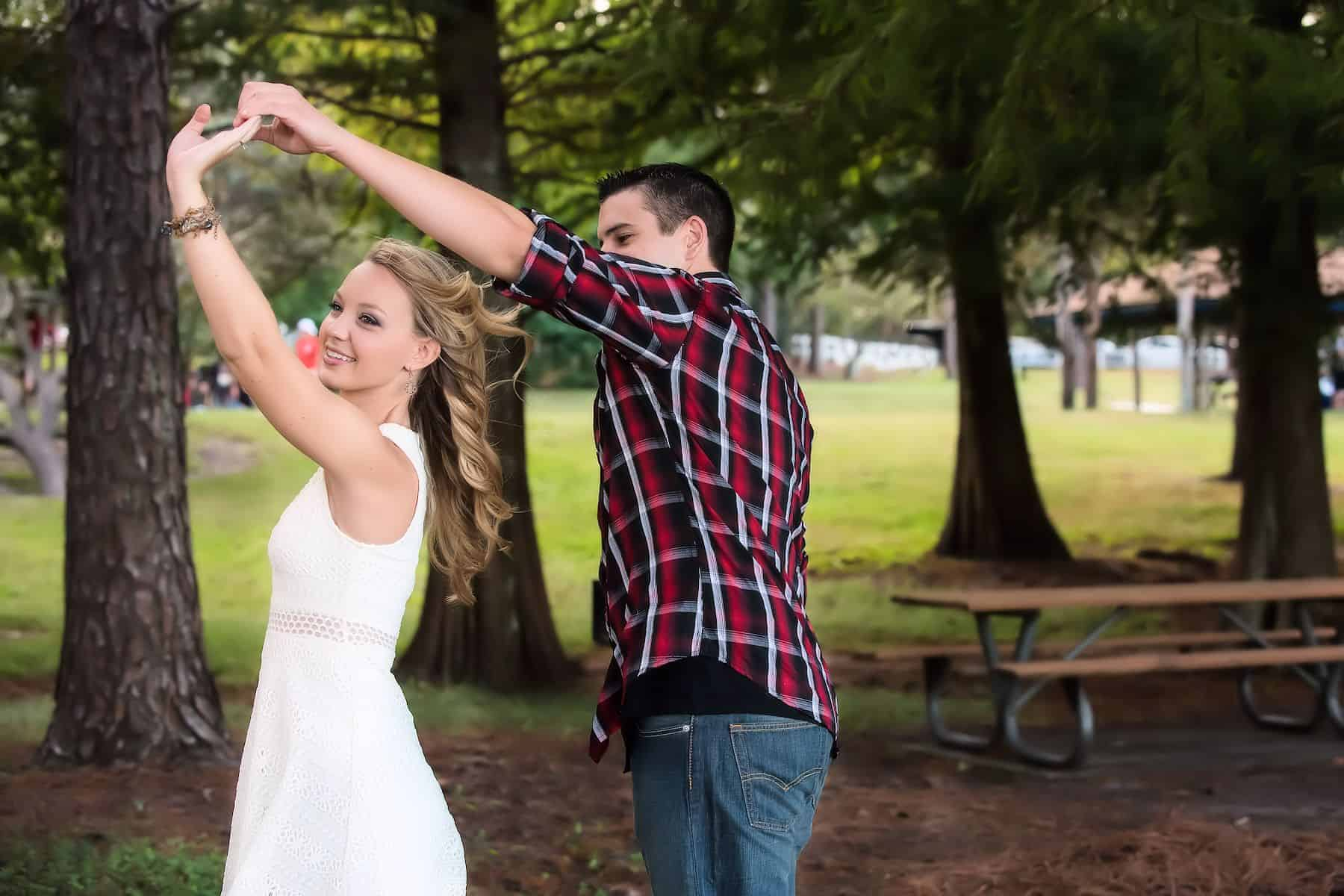 Twirling the bride in the park