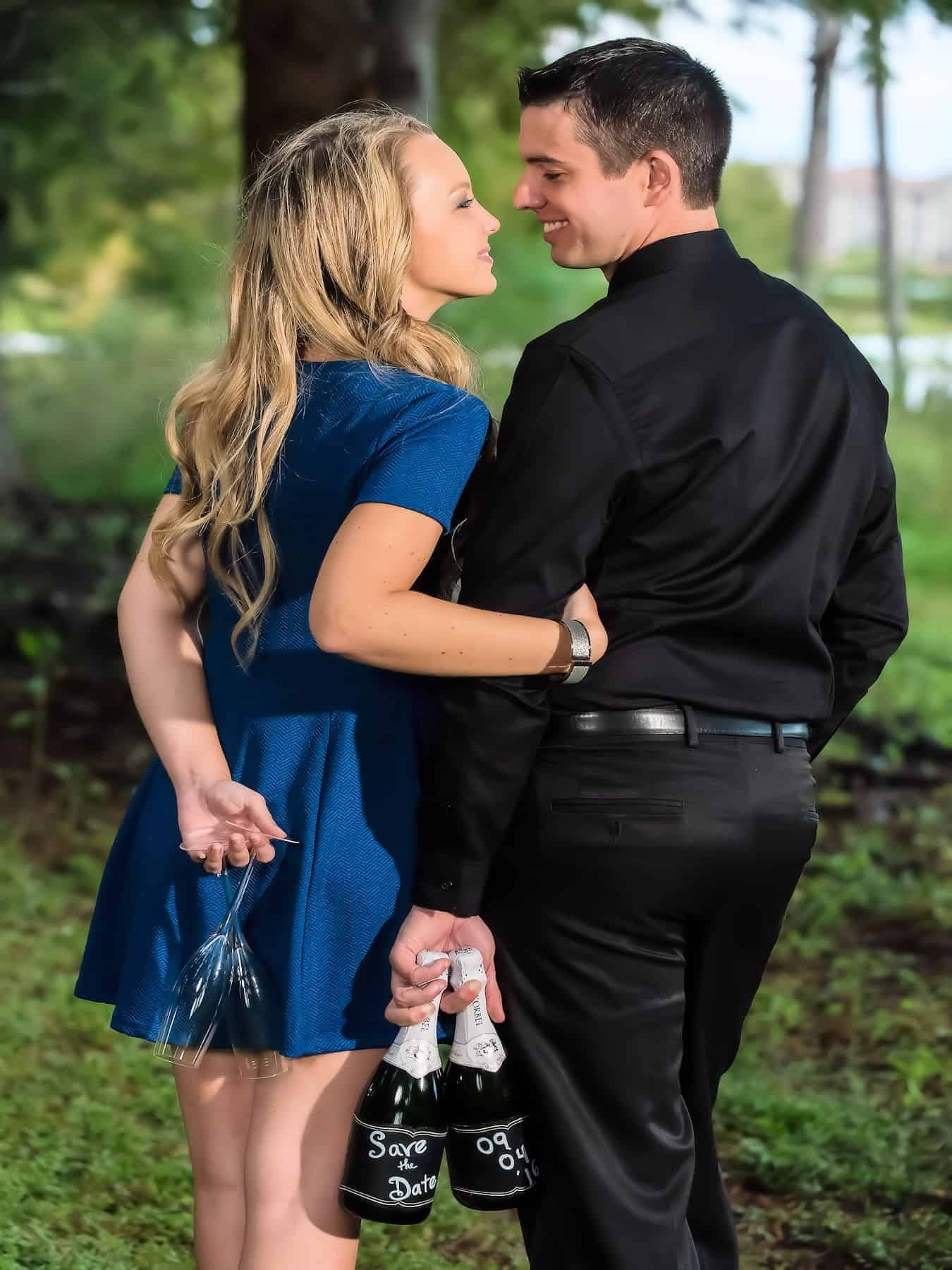Couple enjoy a champagne toast during engagement photos