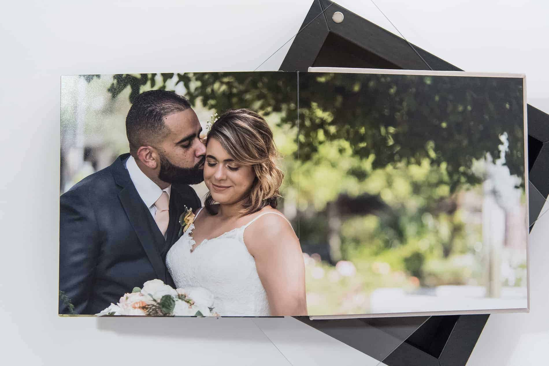 Cute couples wedding album produced by wedding photographers in Orlando