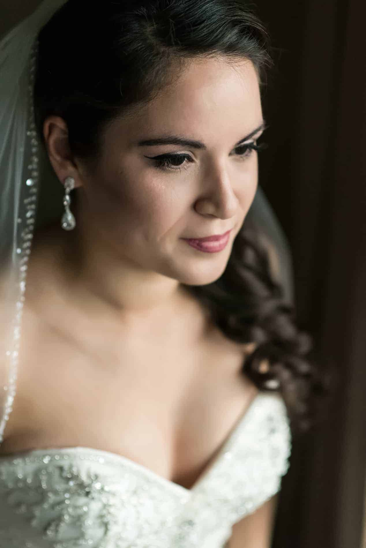 Beautiful Bride Portrait near a widow
