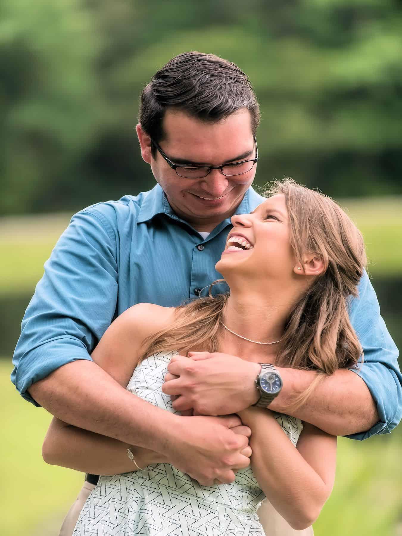 Playful embrace by newly engaged couple