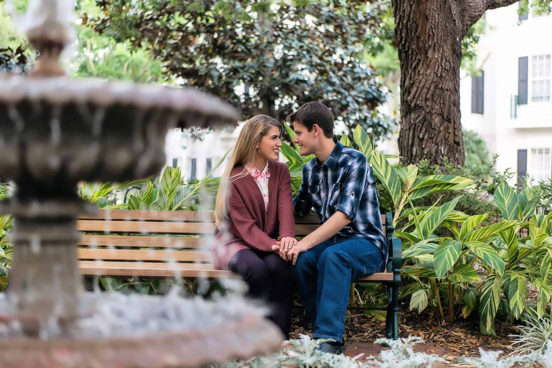 Couple on bench by fountain in an Orlando Engagement Session Location