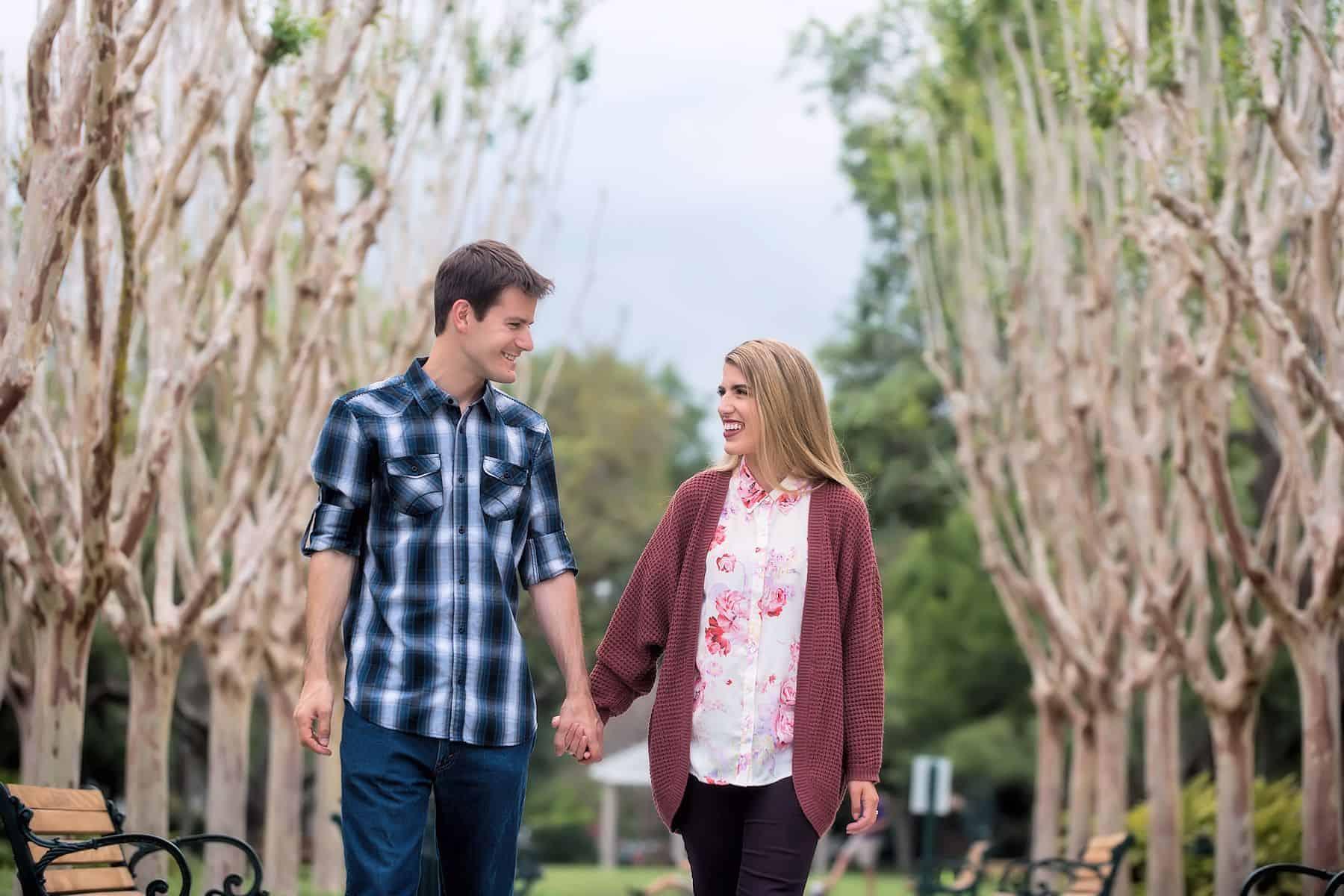 Couple walking among the crepe myrtles in Celebration
