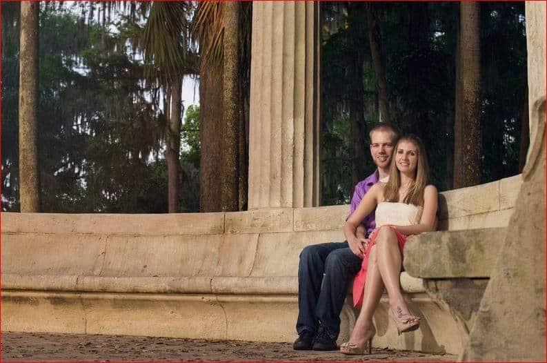 Couple sitting at the Exedra in Kraft Azalea Garden
