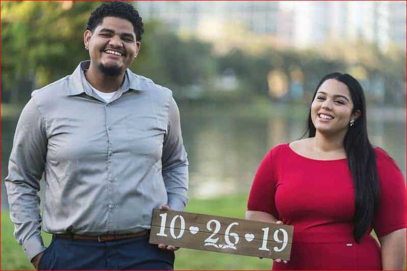 Couple sharing their wedding date at Lake Eola