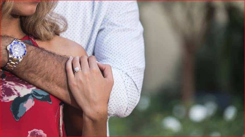 Close embrace and engagement ring