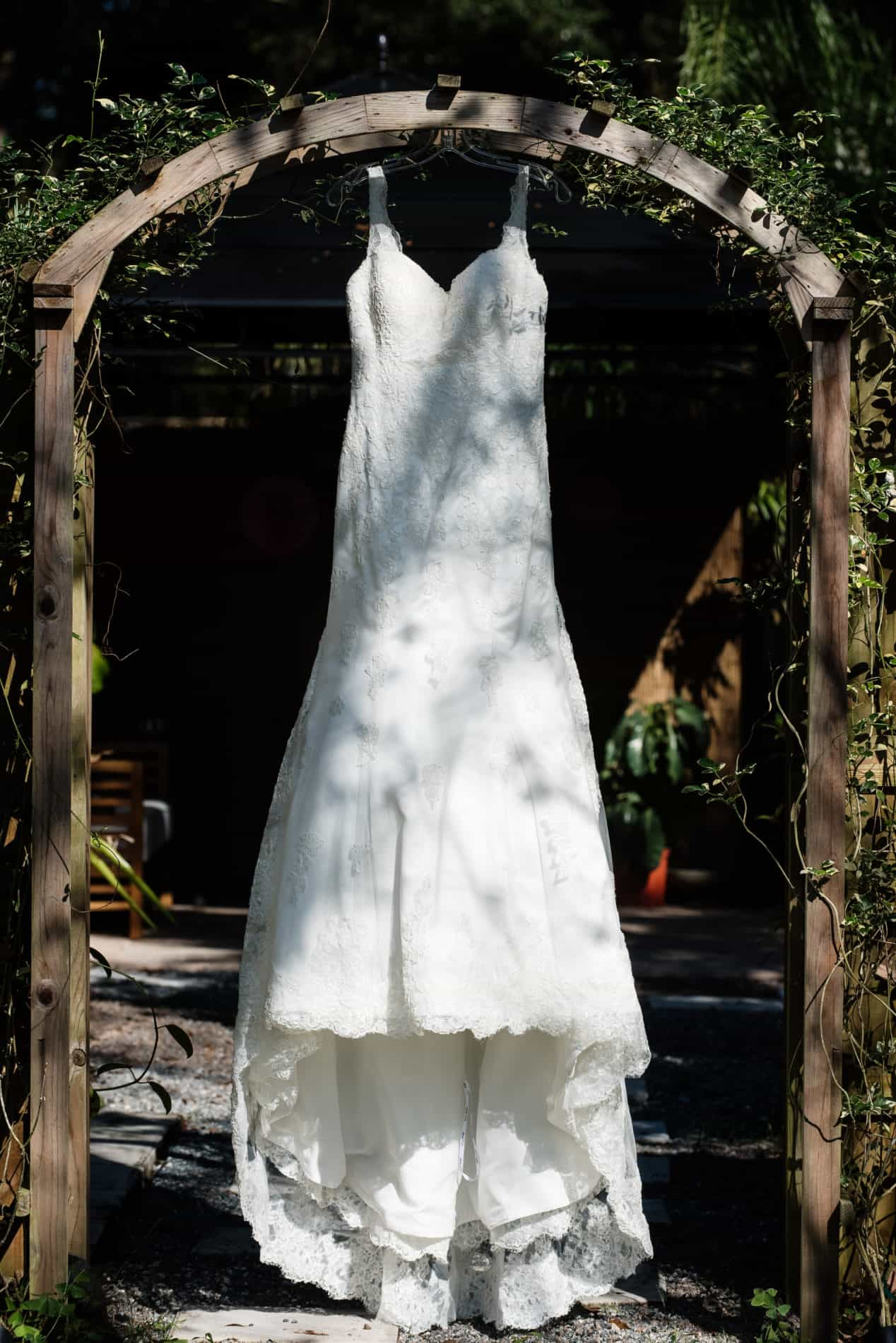 Wedding Dress in rustic arch before outdoor wedding