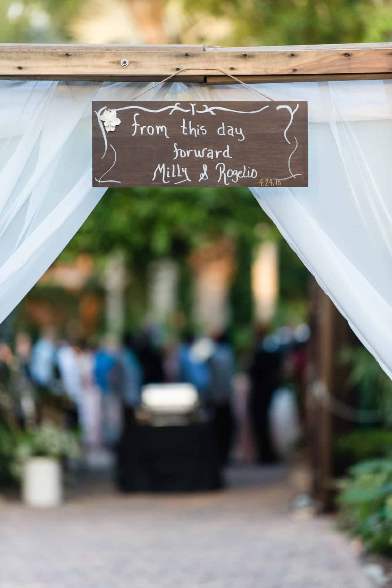 Personalized entrance details to an outdoor wedding reception