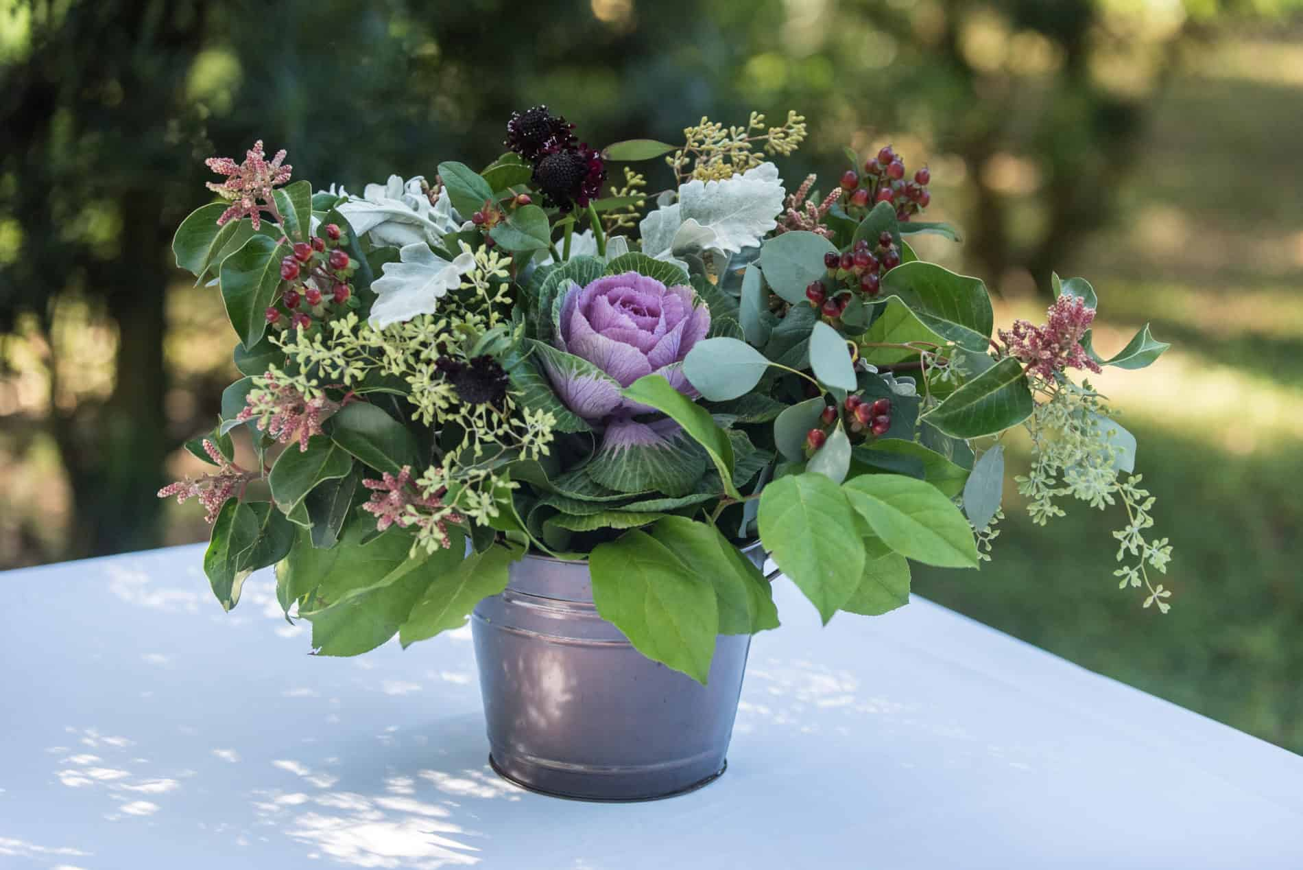 Simple flowered centerpiece at an outdoor wedding