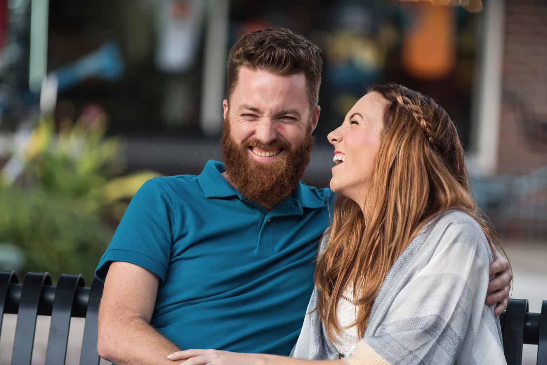 Couple laughs on a bench in Winter Garden