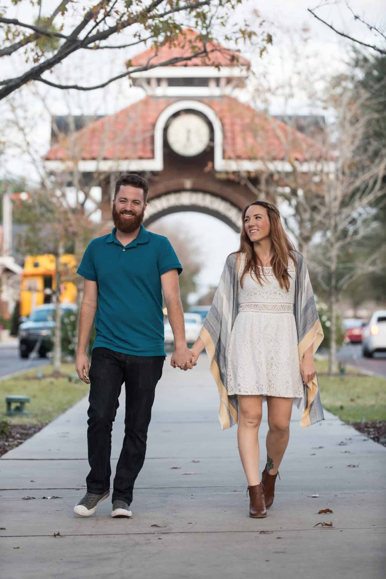 Engaged couple walking in downtown Winter Garden