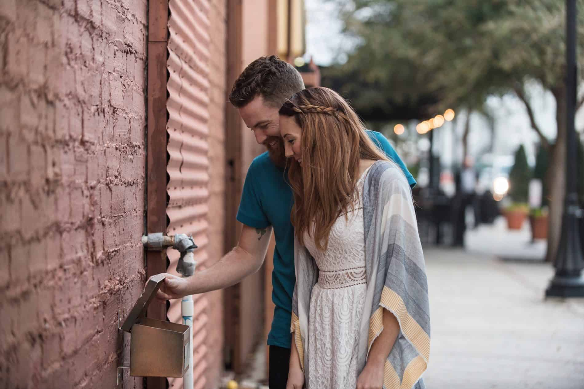 Winter Garden Engaged Couple check out a mailbox