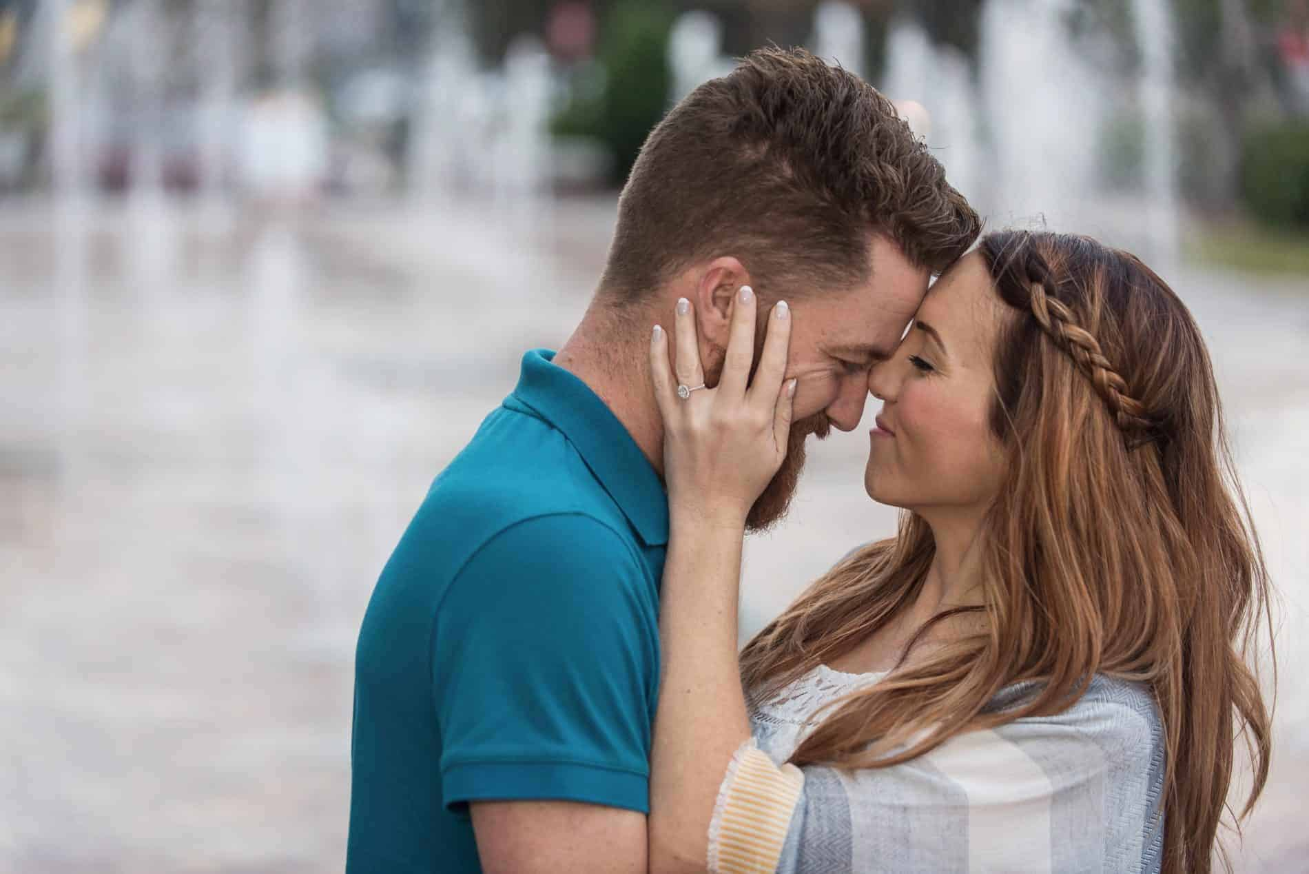 Couple share an intimate moment in Downtown Winter Garden