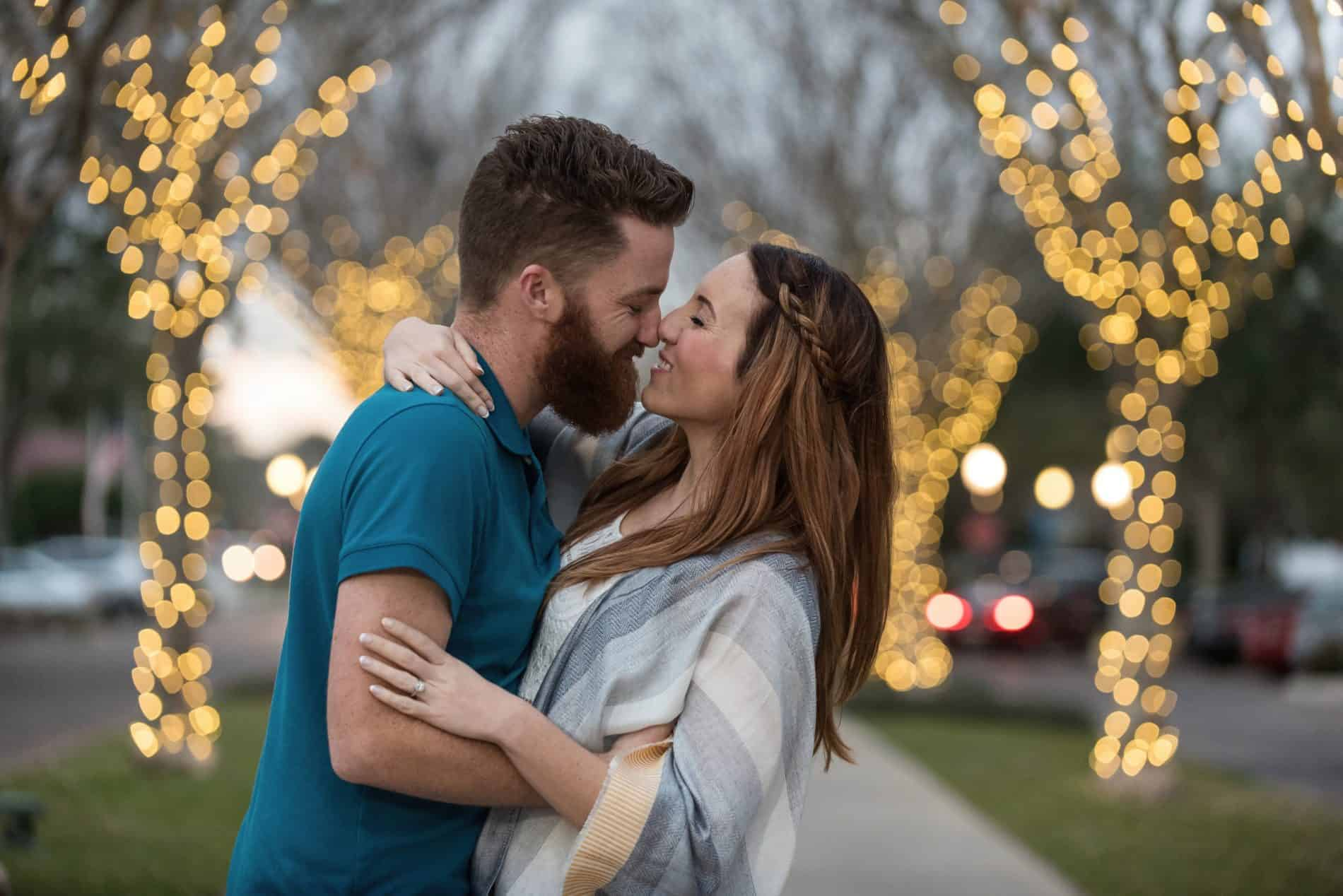 Couple ends their engagement session with a playful kiss