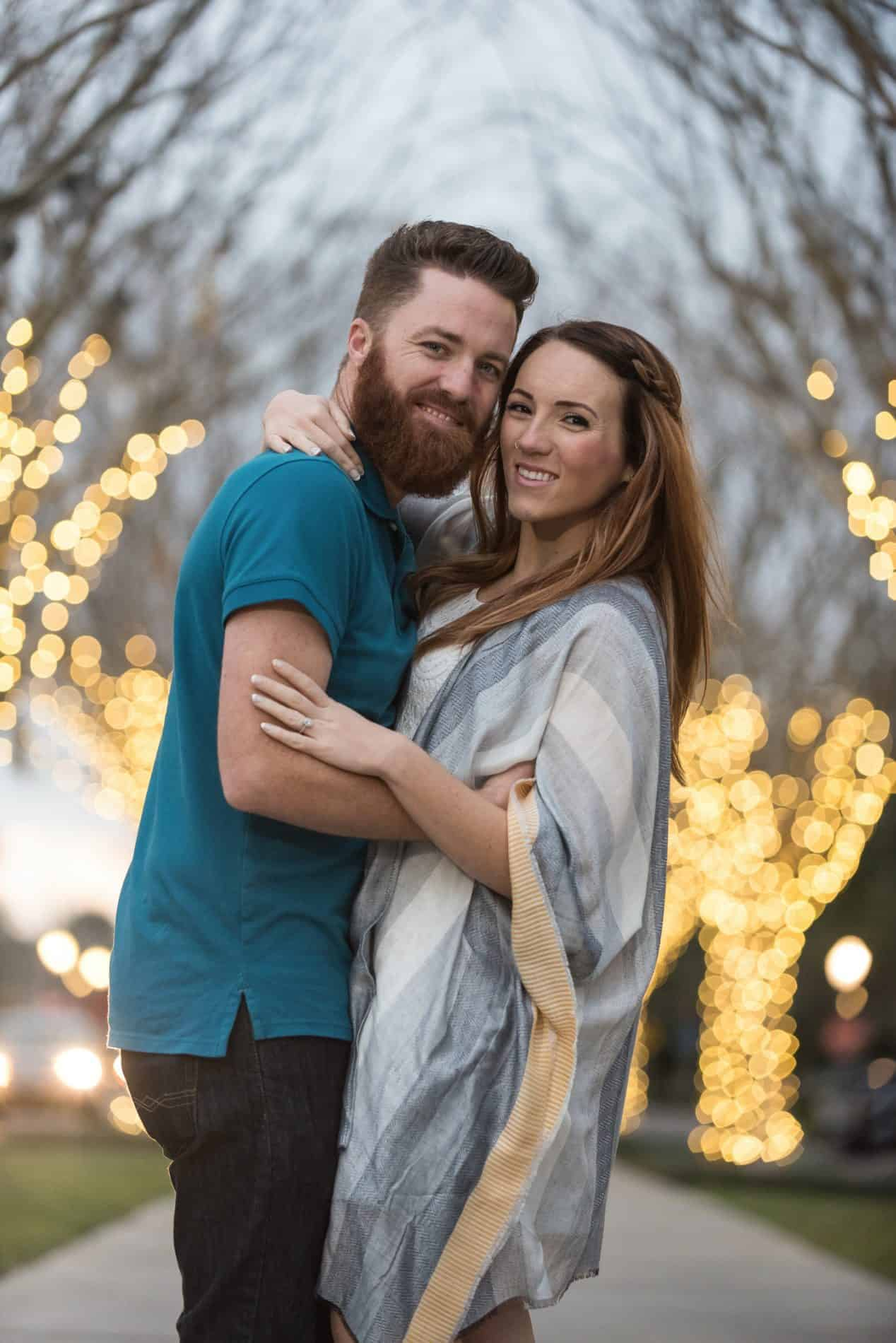 The lights come on in downtown Winter Garden during this couples photo session
