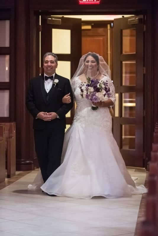 Bride sees her groom as she walks down the aisle in St James Cathedral Orlando