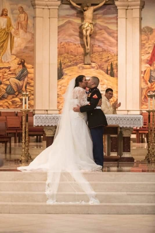 First Kiss at a Beautiful Cathedral Wedding