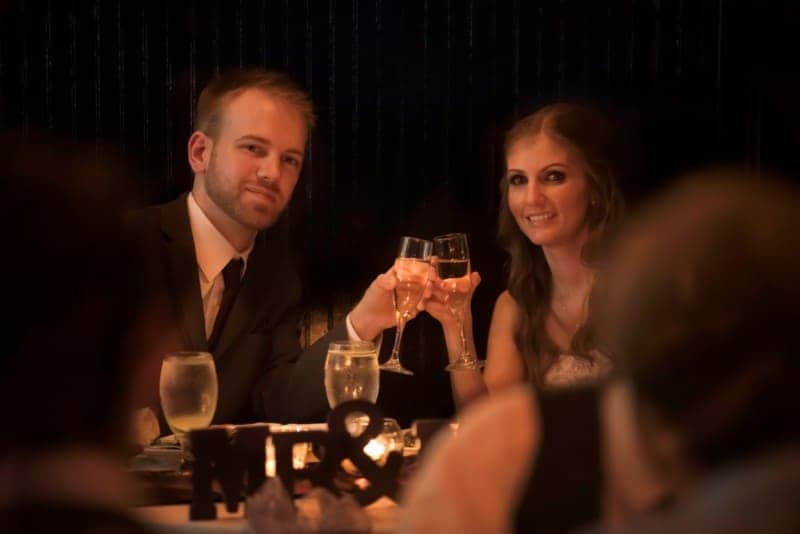 Bride and Groom toasting their wedding at 310 Lakeside