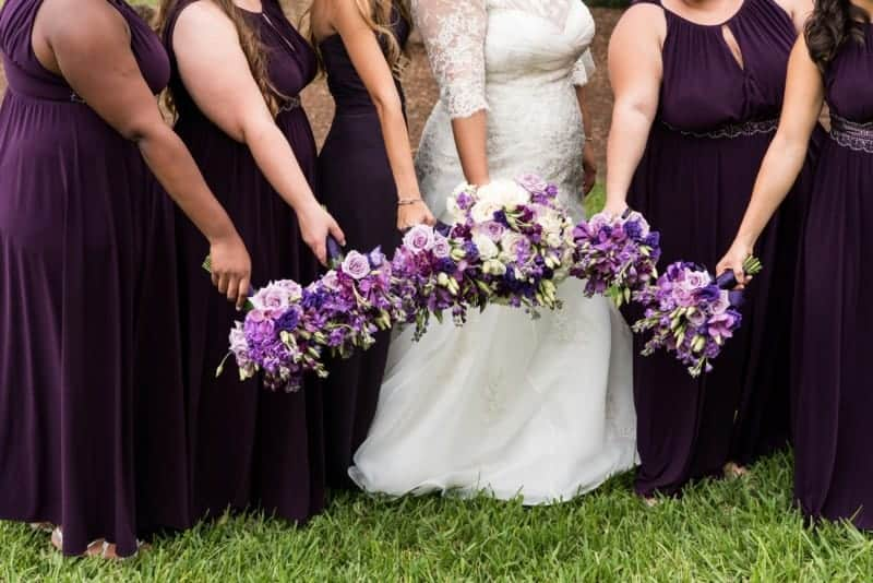 Girls show their wedding bouquets from Raining Roses