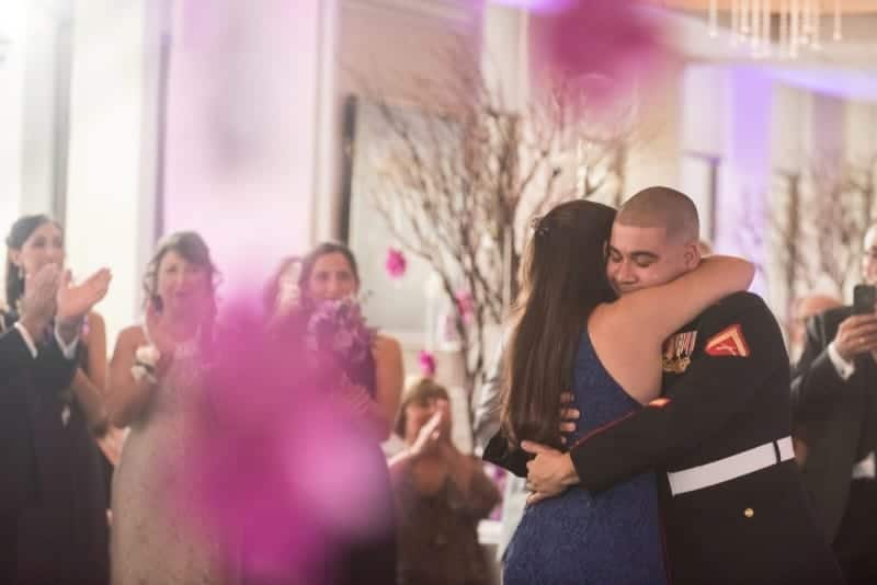 Mother dances with Marine Corps Son at his wedding