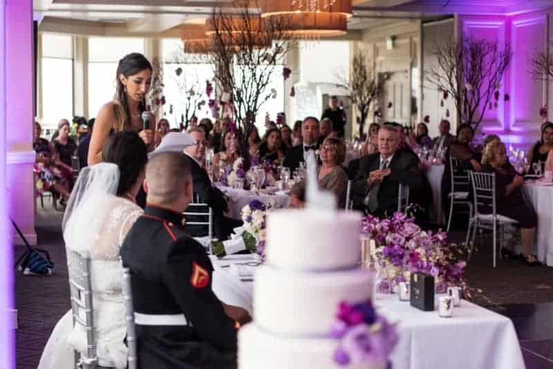 Bride and Groom look on as Maid of Honor gives toast to the couple