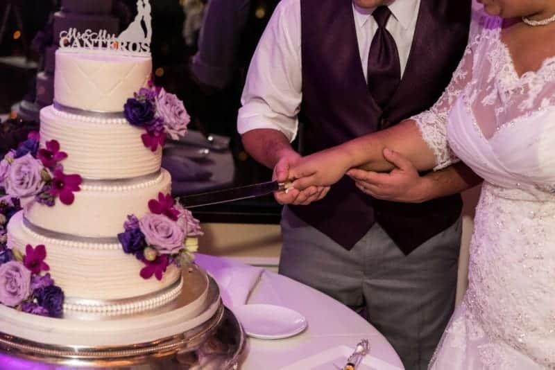 Bride and Groom cutting cake at Citrus Club Wedding