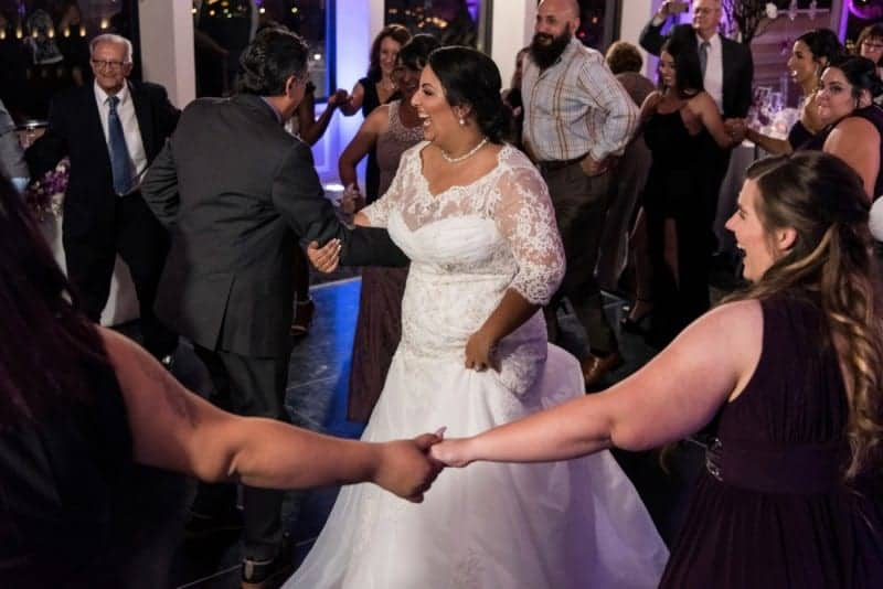 Family dance around the bride at her Citrus Club Wedding