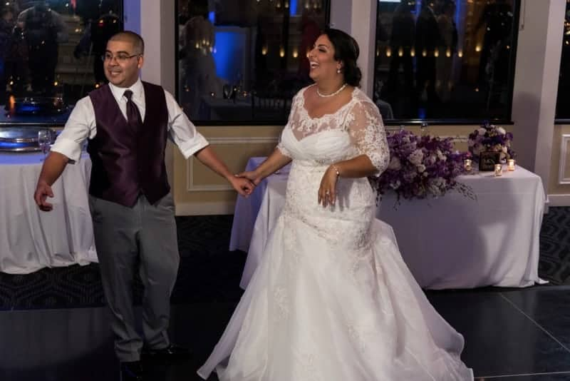 Bride and Groom dance with their friends and family at the Citrus Club