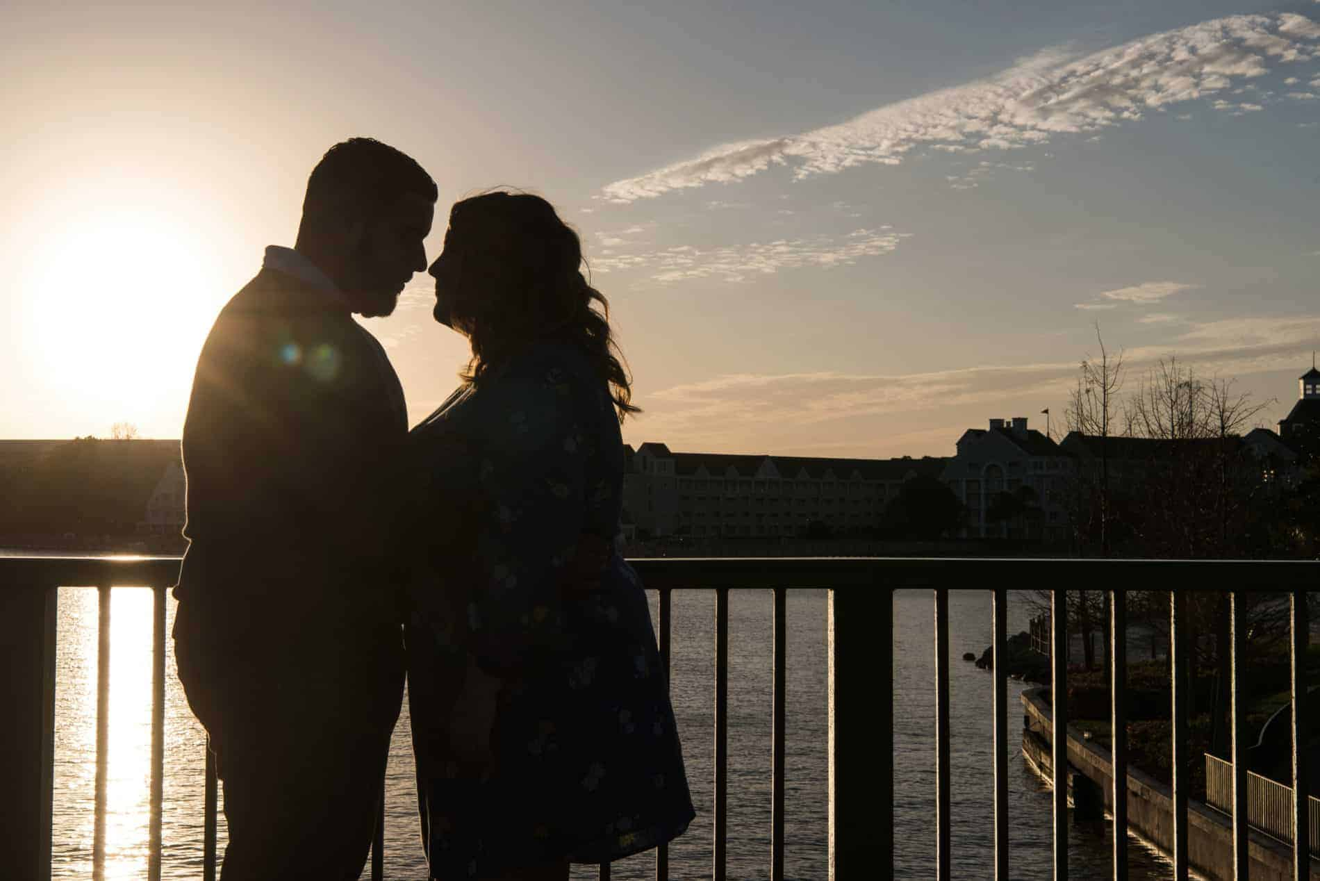 Engaged Couple share a Disney Sunset with each other