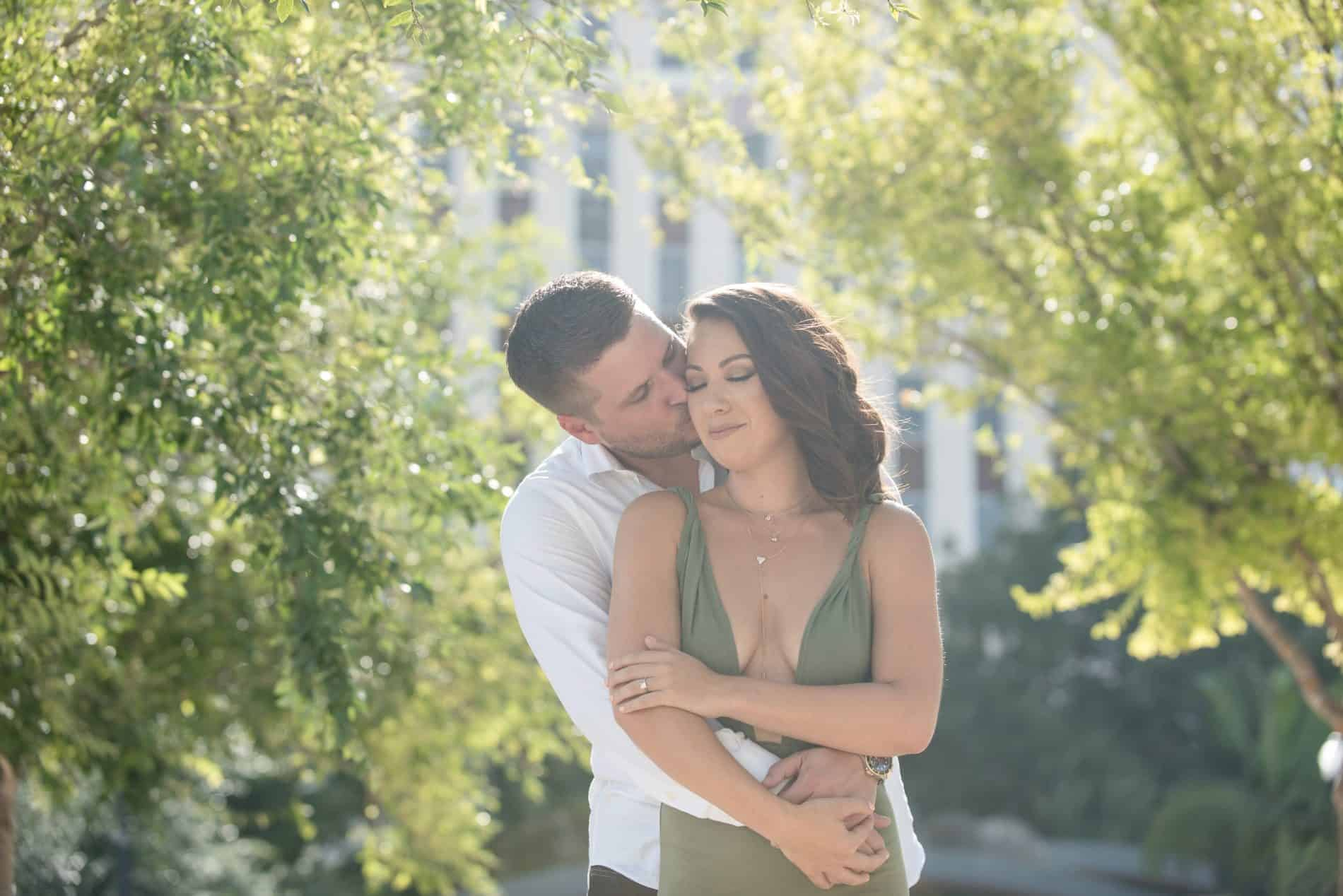 They share an intimate moment among the trees of Dr Phillips Center