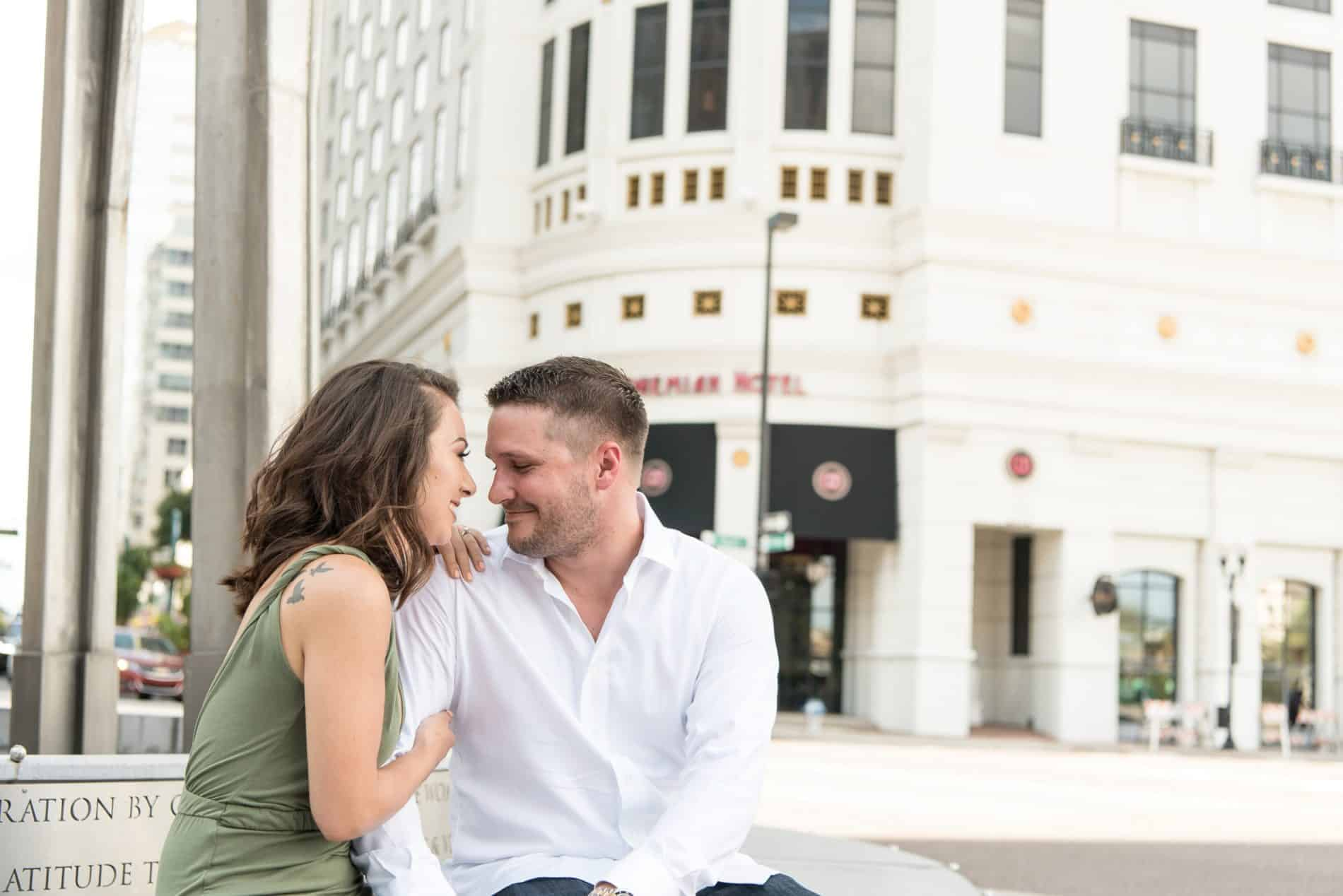 Young Couple sit in Downtown Orlando for Photos