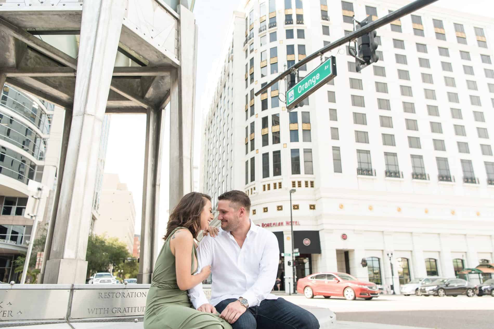Engaged Couple share a moment near the Grand Bohemian Hotel