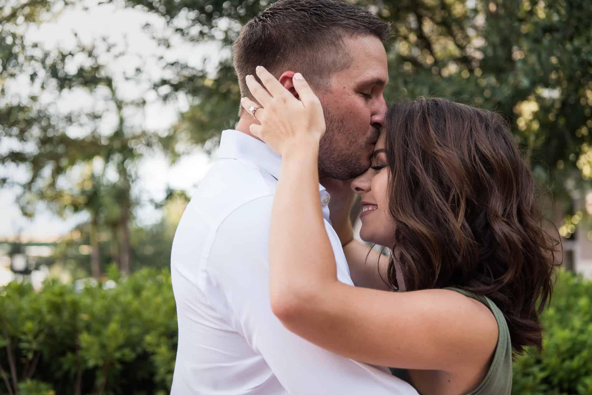Couple embraces in their Orlando engagement Photos