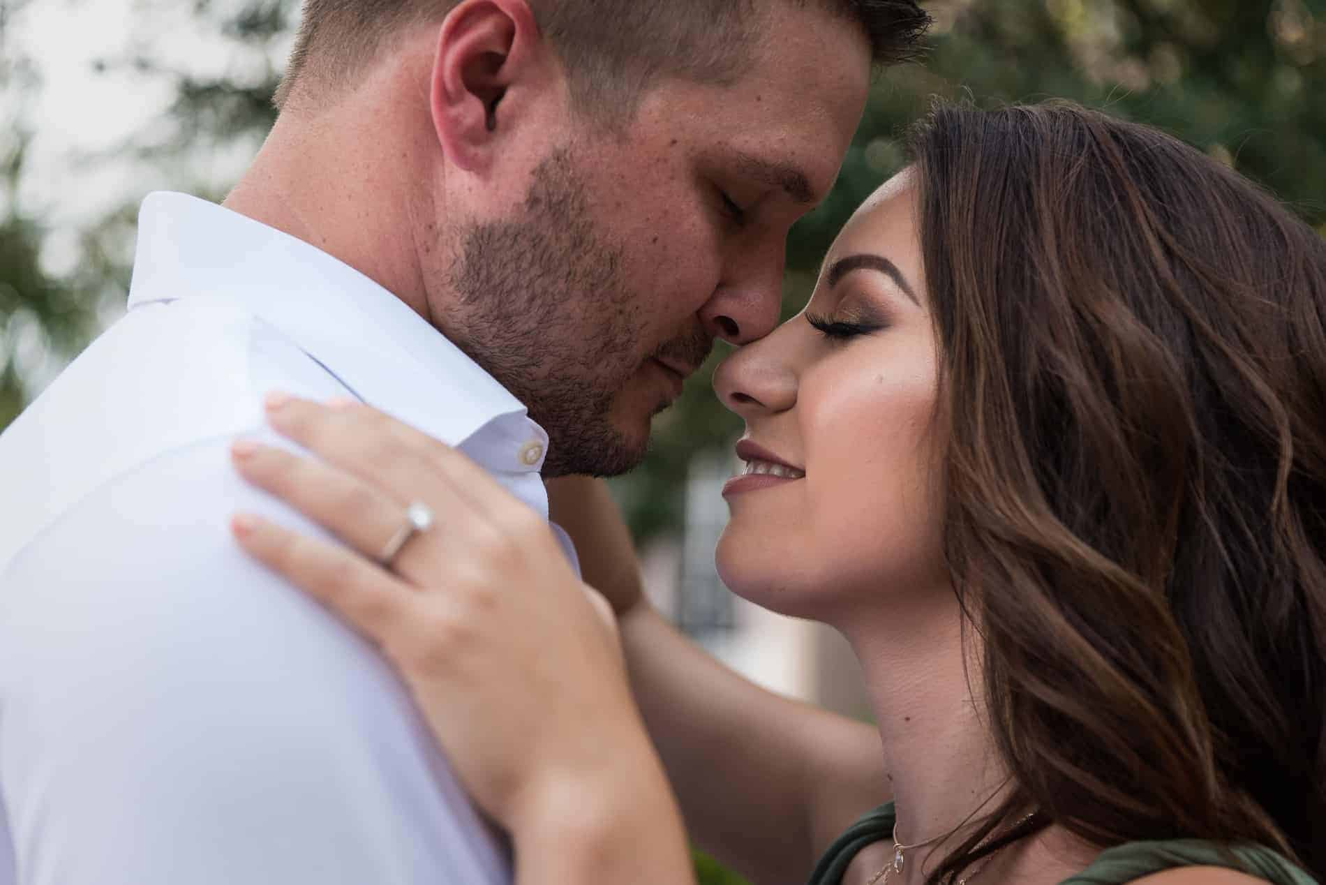 Engaged Orlando Couple hold each other close