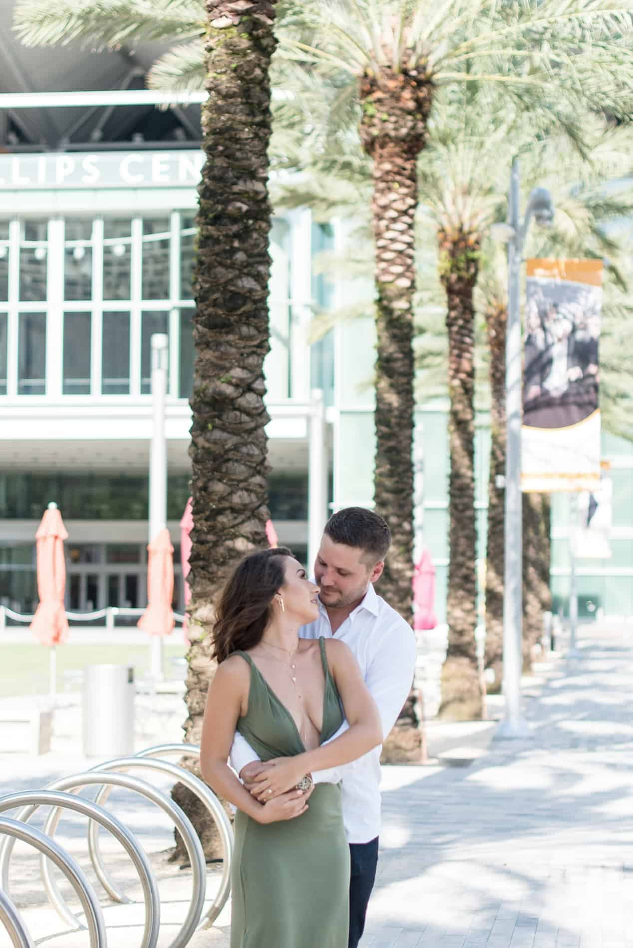 Couple share a moment in front of Dr Phillip Orlando Center for the Arts